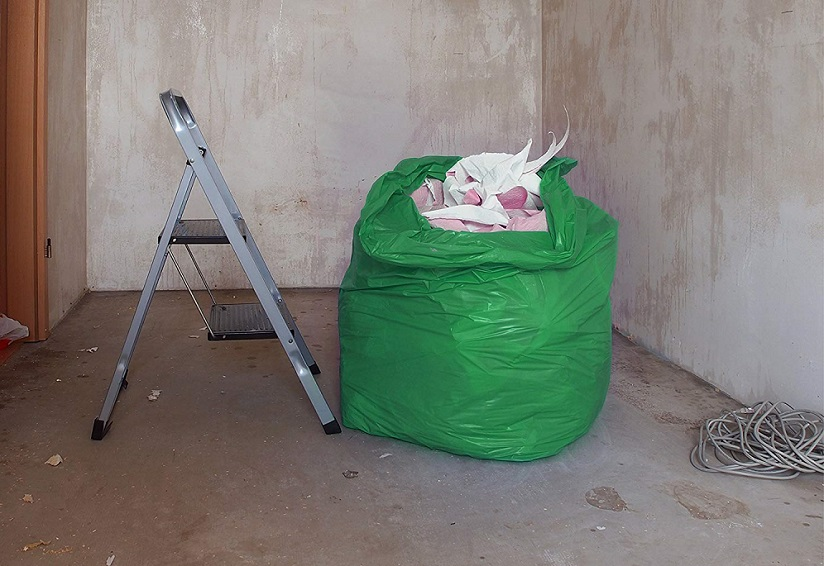 Waste disposal bag by stepladder