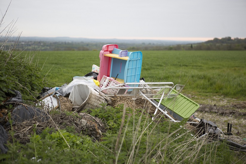 Household waste that has been dumped illegally in a Field.