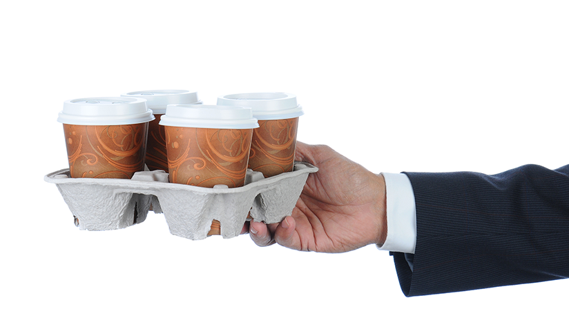 Hand holding tray of disposable coffee cups