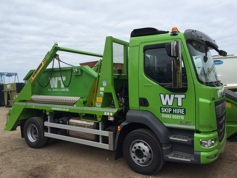WT skip hire skip collection truck in Suffolk